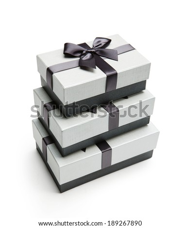 Gift packaging boxes / studio photography of black and white box wrapping ribbon with bowknot - on white background  - stock photo