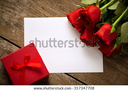 Gift roses and blank paper for valentine day holiday - stock photo