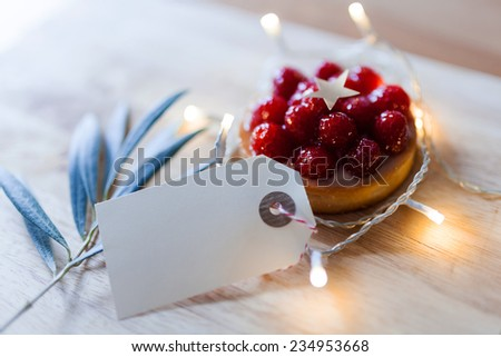 gift tag on a christmas decoration - stock photo