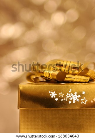 Gift with bokeh background/Gold gift - stock photo