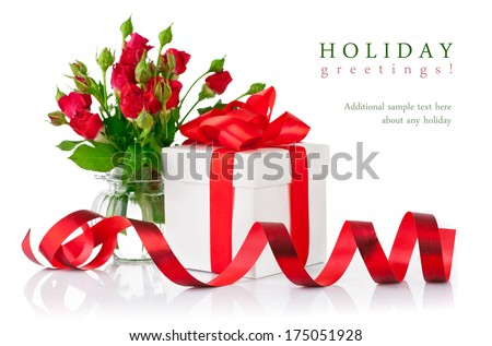 Gift with red bow and bouquet rose. Isolated on white background - stock photo