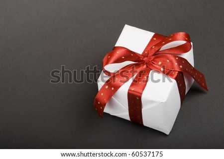 Gift with red ribbon. - stock photo