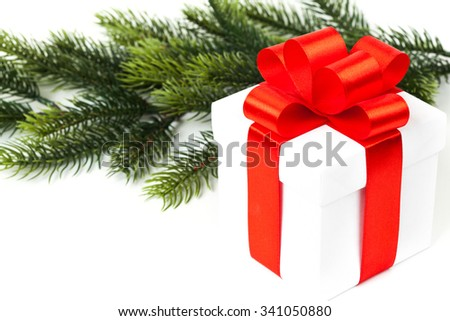 Gift with ribbon and bow isolated on the white background - stock photo