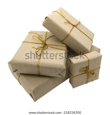 Gift wrapped in brown paper. Isolated on a white background. - stock photo