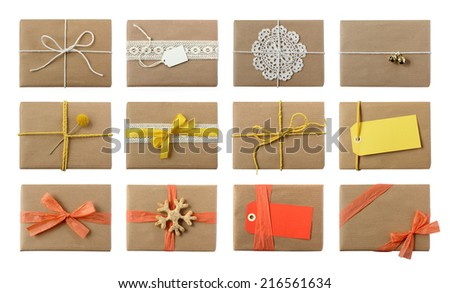 Gift wrapping inspiration - collection of presents in brown paper with creative variety of decorations in warm colors  - isolated on white - stock photo