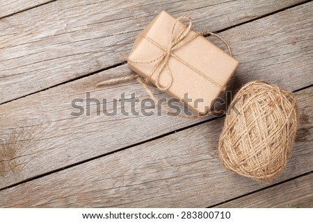 Gift wrapping over wooden table with copy space - stock photo