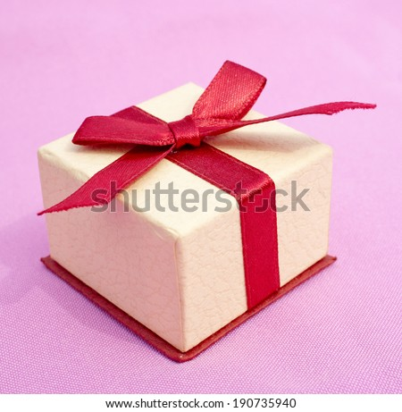 Giftbox with a red bow - stock photo