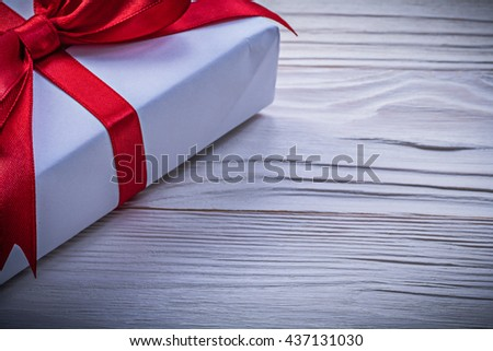 Giftbox with red bow horizontal image holidays concept. - stock photo