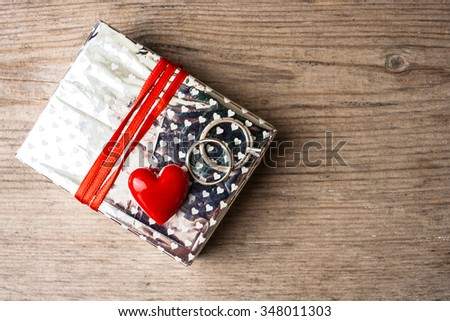 Giftbox with rings and heart, valentines themed