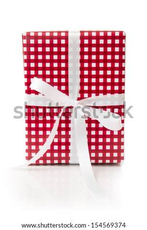 Giftbox wrapped in checkered paper - stock photo