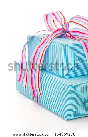 Giftboxes wrapped in blue striped paper