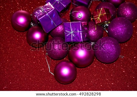 Gifts and Christmas decorations on bright red background