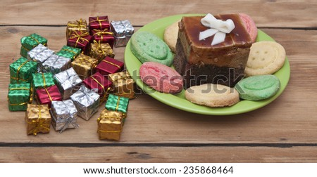 Gifts boxes with a colorful happy birthday cookie - stock photo