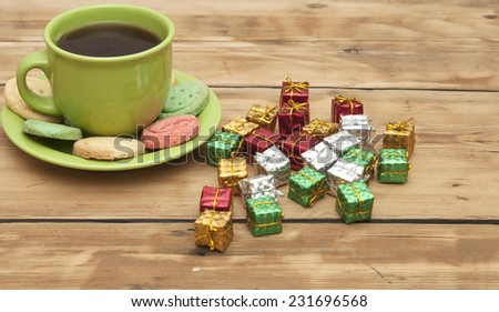Gifts boxes with a colorful happy birthday cookie and tea cup - stock photo