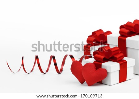 Gifts boxes with red ribbons and textile hearts, valentines day concept