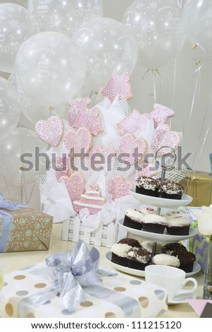Gifts, decorations and cake stand at  party