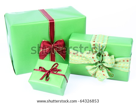 Gifts in green wrapping with bows on white background
