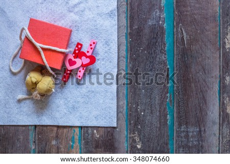 Gifts on a white cloth and old wooden - stock photo