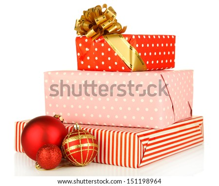 Gifts with christmas balls isolated on white - stock photo