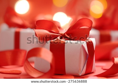 gifts with red ribbons - stock photo