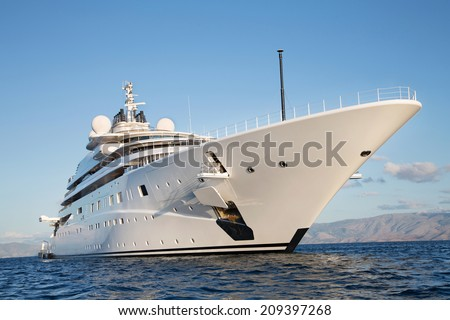 Gigantic big and large luxury mega or super motor yacht on the ocean. - stock photo