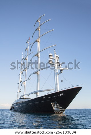 Gigantic big sailing boat or yacht in the blue sea. - stock photo