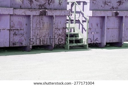 gigantic colored containers of dangerous waste landfill - stock photo
