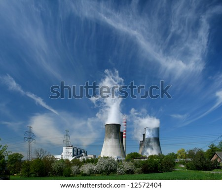 Gigantic power plant in Poland, fruit tree orchards and beautiful clouds
