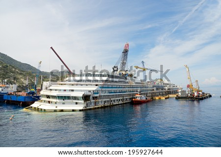 Giglio Island, Tuscany, Italy - April 25 2014: Salvage operation on the wreck of the Costa Concordia ship operated by Titan Salvage company near the harbor