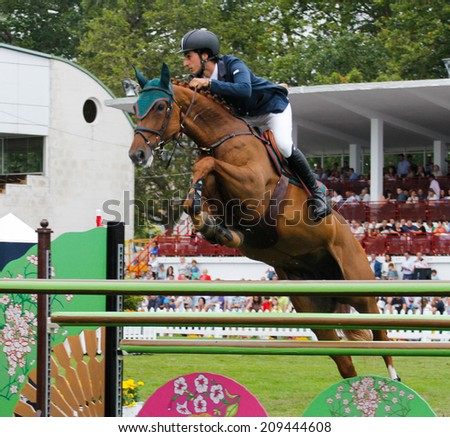 "GIJON, SPAIN  Aug 2014:  Participants in the "" International Jumping Competition CSIO 5 Gijon 2014""  Spain, from July 31 to August 4 - stock photo"