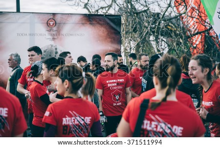 GIJON, SPAIN - JANUARY 31, 2016: Runners into the Farinato Race event, a extreme obstacle race, celebrated in Gijon, Spain, on January 31, 2016. Local  team awaiting to start the race. - stock photo