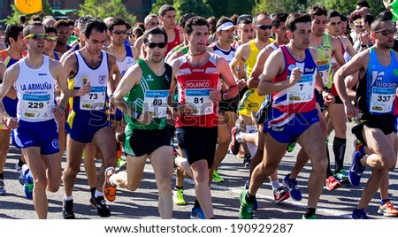 GIJON, SPAIN - MAY 3, 2014: Participants in the annual half marathon in the city of Gijon, Spain, on Saturday, May 3, 2014.