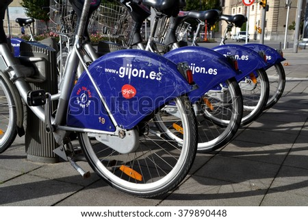 GIJON, SPAIN - OCTOBER 23: Some bicycles of the bike rental service in Gijon, Spain on October 23, 2014. Gijon Bici is a bike sharing service that people can rent bicycles for short trips.