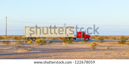 GILA BEND, USA - JULY 11: truck on interstate 8 in early morning at July 11, 2012 in Gila Bend, USA. I-8 was part of the original 1957 plan of Interstates, following US 80 from San Diego to Gila Bend.