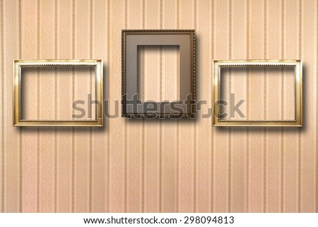 Gilded wooden frames for pictures on striped background