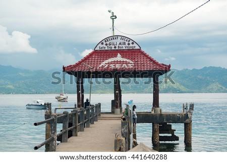Gili Air, Indonesia - May 6, 2013 - Pier for boats doing island hopping between Lombok, Gili Air, Meno and Trawangan islands - stock photo