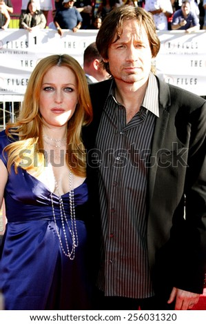 """Gillian Anderson and David Duchovny at the World Premiere of """"The X-Files: I Want To Believe"""" held at the Grauman's Chinese Theater in Hollywood, California, United States on July 23, 2008.  - stock photo"""