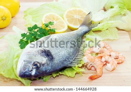 Gilthead fish is ready to be cooked - stock photo