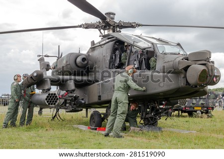 GILZE-RIJEN, NETHERLANDS - JUNE 20, 2014: Ground crew preparing a AH-64 Apache attack helicopter at the Royal Netherlands Air Force Days . - stock photo