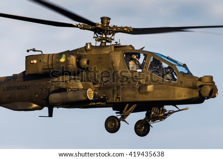 GILZE-RIJEN, THE NETHERLANDS - DECEMBER 14, 2015: Dutch Air Force AH-64 Apache attack helicopter during a training at the Gilze-Rijen Air Base on December 14, 2016, The Netherlands. - stock photo