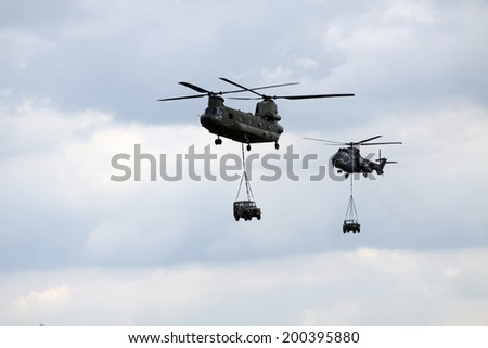 GILZE-RIJEN, THE NETHERLANDS - 21 JUNE : Chinook transport helicopter and another helicopter during a demonstration at the air force days Juni 21,2014 in Gilze-Rijen , The netherlands.