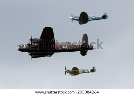 GILZE RIJEN, THE NETHERLANDS - JUNE 21: RAF Historical flight with a Lancaster and Spitfires flying on the Royal Dutch Air Force Open House. June 21, 2014 in Gilze-Rijen, The Netherlands - stock photo