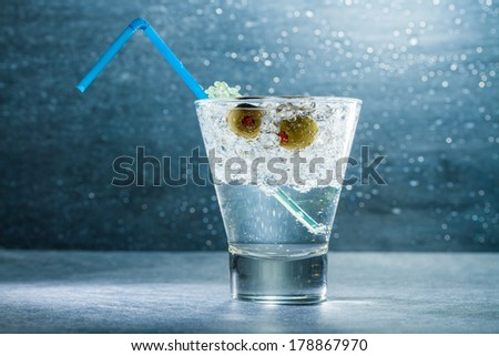 Gin Cocktail with crushed ice and olives - stock photo