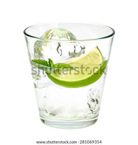 Gin tonic cocktail and lime wedge on white background including clipping path - stock photo