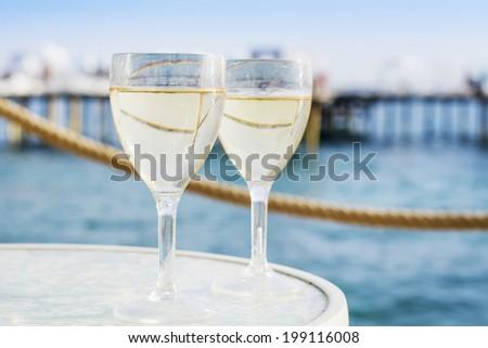 Gin tonic cocktail with lemon slice - stock photo