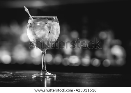 Gin tonic in a glass with ice rocks. - stock photo