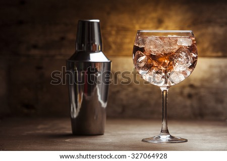 Gin tonic on a wooden background
