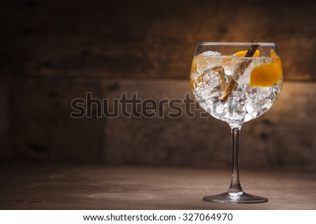 Gin tonic on a wooden background - stock photo