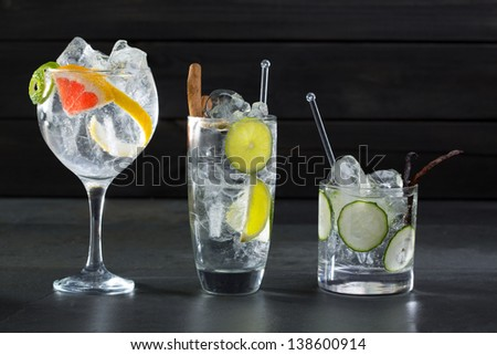 Gin tonic varied cocktails with lima cucumber and grapefruit - stock photo