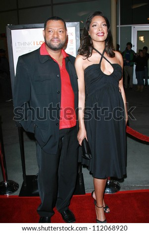 "Gina Torres and Laurence Fishburne at the premiere of ""I Think I Love My Wife"". ArcLight Theatre, Hollywood, CA. 03-07-07"